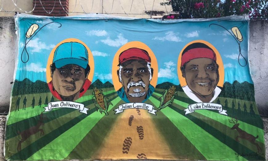Plasman en mural los rostros de tres defensores rarámuri